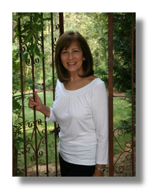 Sheri Baker, EFT-ADV, Standing at Gate in Garden